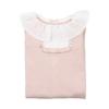 Babygrow de bebé dobrado rosa com bolinhas em relevo e gola em tecido.