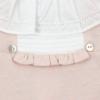 Gola em tecido de babygrow de bebé rosa com bolas em relevo.