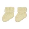 Carapins de bebé amarelos feitos em malha de algodão.