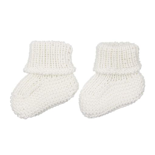 Carapins de bebé brancos feitos em malha de algodão.