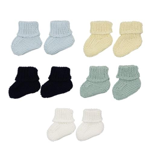 Conjunto de cinco carapins de bebé em malha de algodão de diversas cores.