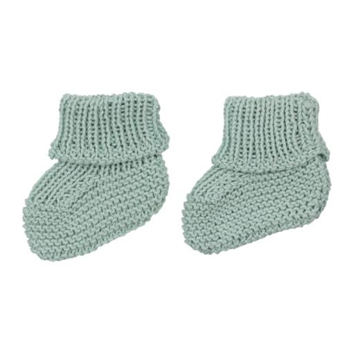 Carapins de bebé verdes feitos em malha de algodão.