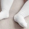 Collant de bebé de cor branca
