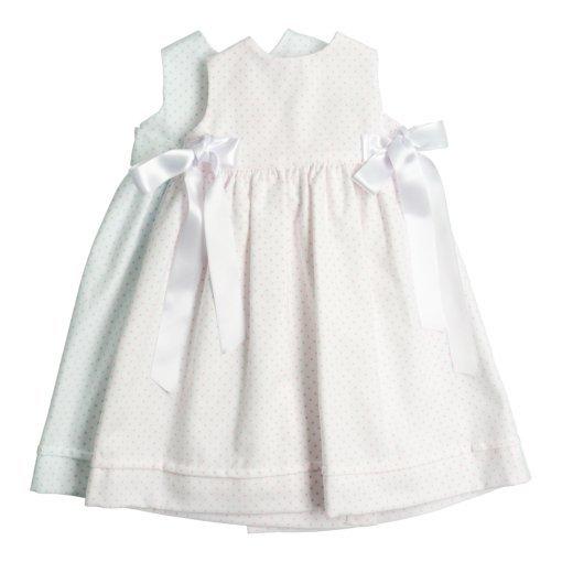 Cueiros para bebé recém-nascido branco com pintas azuis e rosa claro.