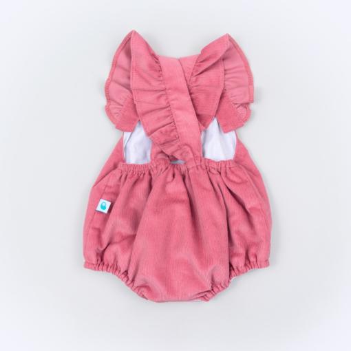 Vista trás fofo de bebé em bombazine cor de rosa.