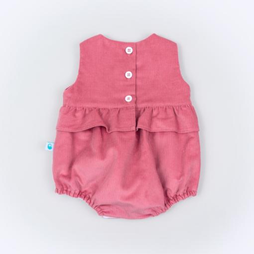 Vista de trás de um Fofo para bebe em bombazine cor de rosa com folho à volta.