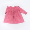 Vista Trás Vestido de bebé em bombazine cor de rosa.