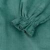 Pormenor Vestido de bebé em bombazine verde.