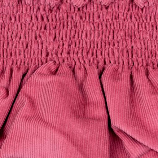 Pormenor tapa-fraldas para bebe em bombazine cor de rosa.