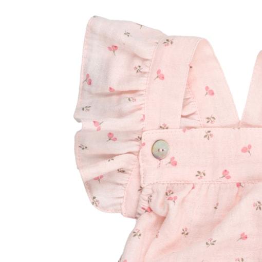 Alça com folhos de fofo de bebé em tecido rosa com estampado em flores. É feito em tecido 100% algodão orgânico.