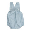 Fofo de bebé em tecido de algodão azul claro com um padrão de estrelas brancas estampado. Tem botões de massa branca nas alças.