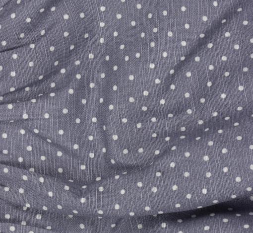 Tecido em linho azul com bolas brancas.