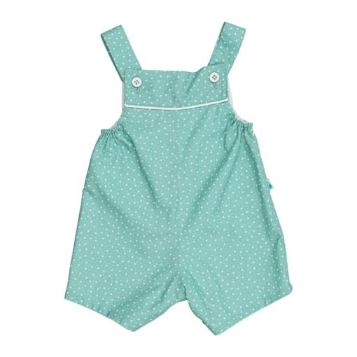 Jardineiras de bebé com perna curta em tecido de algodão de cor verde com estampado de flores brancas. Tem botões de massa branca.