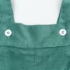 Pormenor jardineira de bebé em bombazine verde.