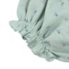 Elástico da zona da perna de tapa Fraldas de bebé em tecido de algodão orgânico verde com flores estampadas.