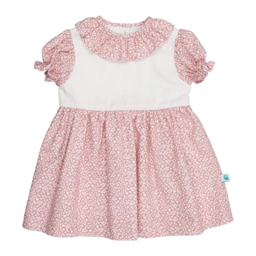 Vestido para bebé cor de rosa com estampado de flores brancas e gola em tecido.