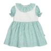 Vestido para bebé verde claro com estampado de flores brancas e gola em tecido.